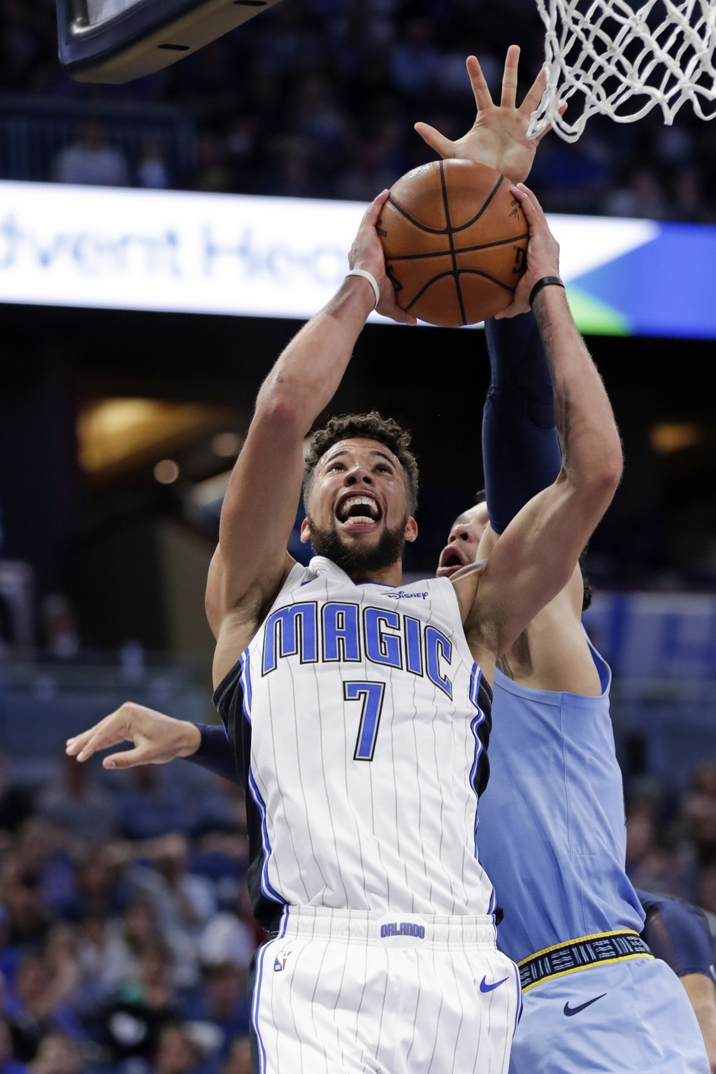 Orlando Magic's Michael Carter-Williams (7) goes up to shoot against Memphis Grizzlies' Dillon Brooks, right, during the first half of an NBA basketba...