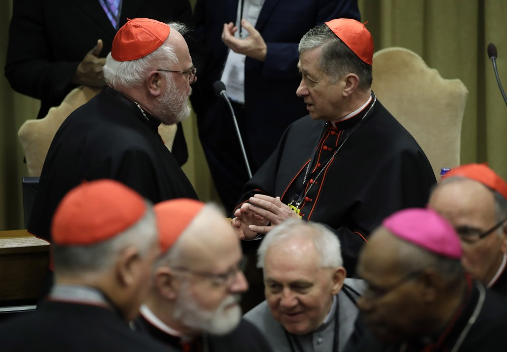 FILE - In this Feb. 23, 2019, file photo, Cardinal Blase J. Cupich of Chicago, right, talks with Cardinal Reinhard Marx of Munich at the Vatican. Germ...