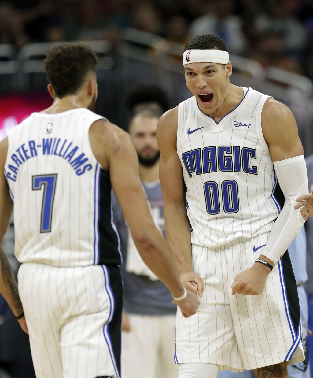 Orlando Magic's Aaron Gordon (00) reacts after dunking against the Memphis Grizzlies with an assist by Michael Carter-Williams (7) during the second h...