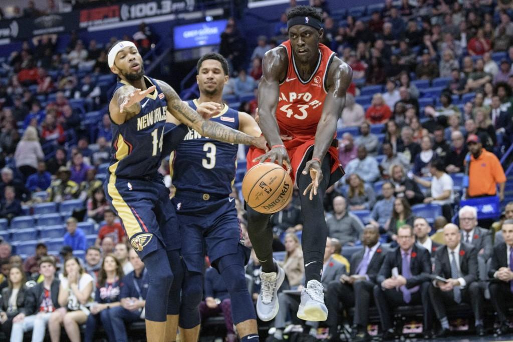 Toronto Raptors forward Pascal Siakam (43) passes as New Orleans Pelicans guard Josh Hart (3) collides with New Orleans Pelicans forward Brandon Ingra...