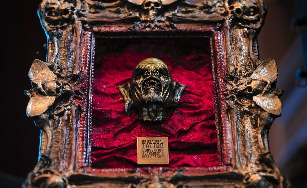 In this Saturday, Nov. 2, 2019, the best in show trophy is on display during the 10th International Tattoo Convention in Bucharest, Romania. The three...