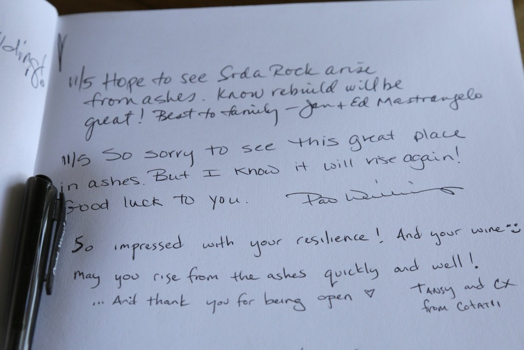 This Wednesday, Nov. 6, 2019, photo, shows messages left in a guest book on the counter in a tasting area at the wildfire damaged Soda Rock Winery in ...