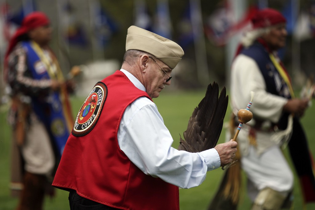 FILE - In this June 15, 2012, file photo, Jerry Best, a Vietnam War veteran of the Cheyenne tribe, dances on during a Native American blessing for vet...