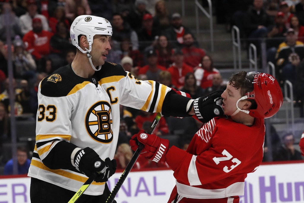 Boston Bruins defenseman Zdeno Chara (33) pushes Detroit Red Wings left wing Adam Erne (73) during the second period of an NHL hockey game, Friday, No...