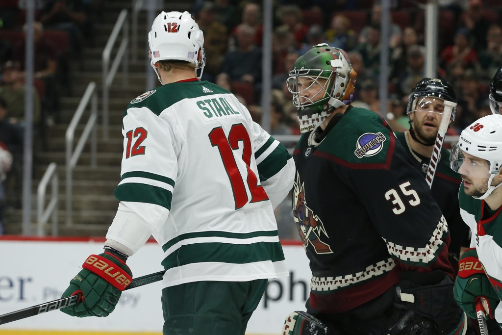 Minnesota Wild center Eric Staal (12) and Arizona Coyotes goaltender Darcy Kuemper (35) talk in the first period during an NHL hockey game, Saturday, ...