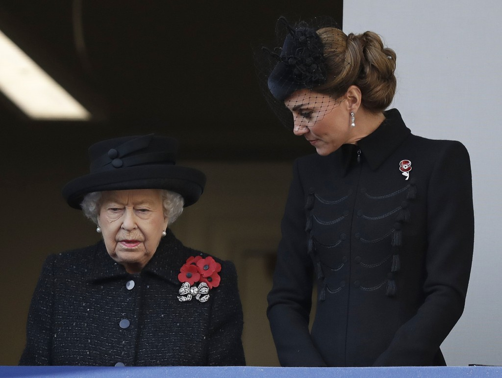 Queen Elizabeth takes part in Remembrance Sunday service with royal family