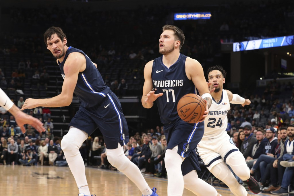 Memphis Grizzlies' Dillon Brooks (24) tries to catch Dallas Mavericks; Luka Doncic (77) during the first half of an NBA basketball game Saturday, Nov....