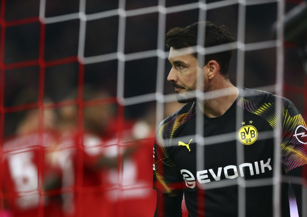 Dortmund's goalkeeper Roman Buerki reacts after Dortmund's Mats Hummels scores an own goal during the German Bundesliga soccer match between FC Bayern...