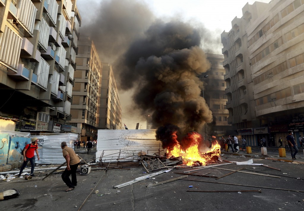 Anti-government protesters set fire and close streets during ongoing protests in Baghdad, Iraq, in central Baghdad, Iraq, Saturday, Nov. 9, 2019.   Ir...