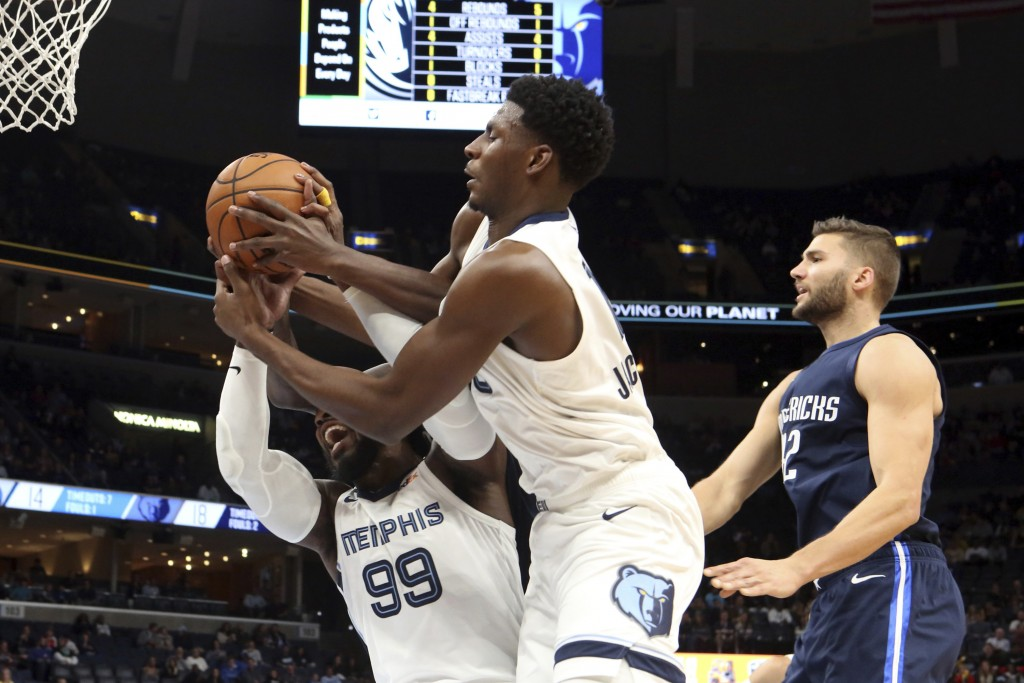 Memphis Grizzlies' Jaren Jackson Jr. (13) and Jae Crowder (99) grab a rebound during the first half of the team's NBA basketball game against Dallas M...