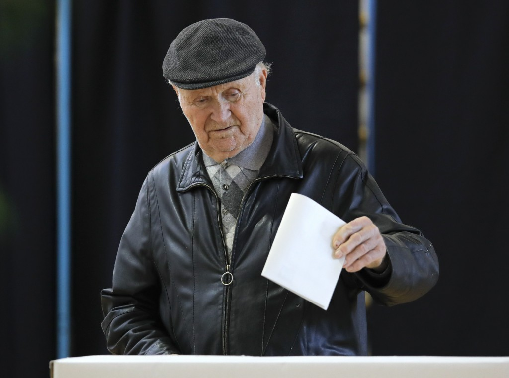 A man casts his vote in Bucharest, Romania, Sunday, Nov. 10, 2019. Voting got underway in Romania's presidential election after a lackluster campaign ...