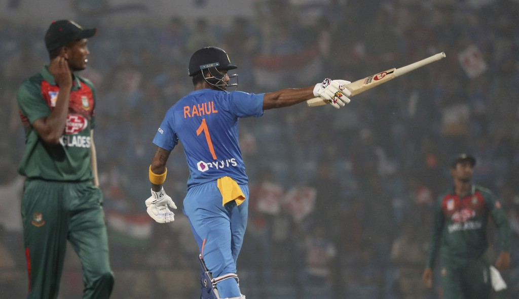 India's K.L. Rahul raises his bat after scoring fifty runs during third Twenty20 international cricket match against Bangladesh in Nagpur, India, Sund...