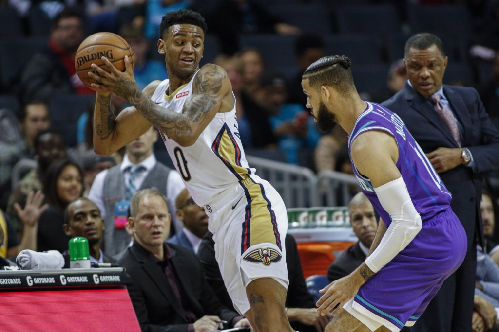 New Orleans Pelicans guard Nickeil Alexander-Walker, left, looks to pass against Charlotte Hornets forward Cody Martin in the first half of an NBA bas...