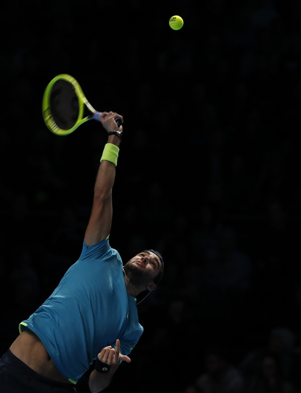 Italy's Matteo Berrettini serves to Serbia's Novak Djokovic during their ATP World Tour Finals singles tennis match at the O2 Arena in London, Sunday,...