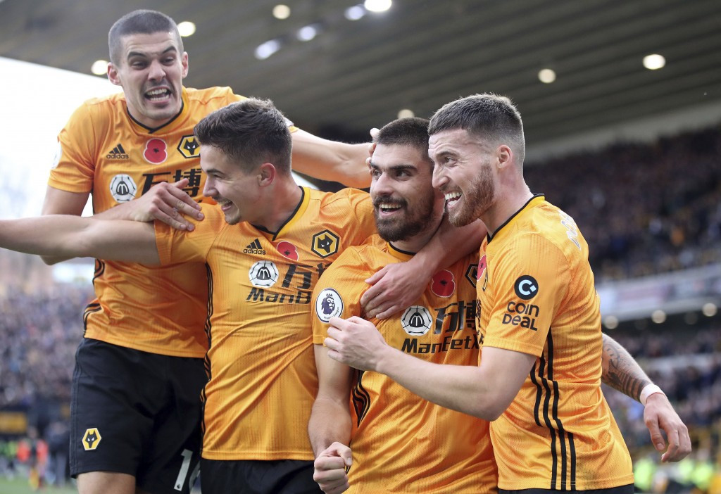 Wolverhampton Wanderers' Ruben Neves, center, celebrates scoring his side's first goal of the game with teammates during their English Premier League ...