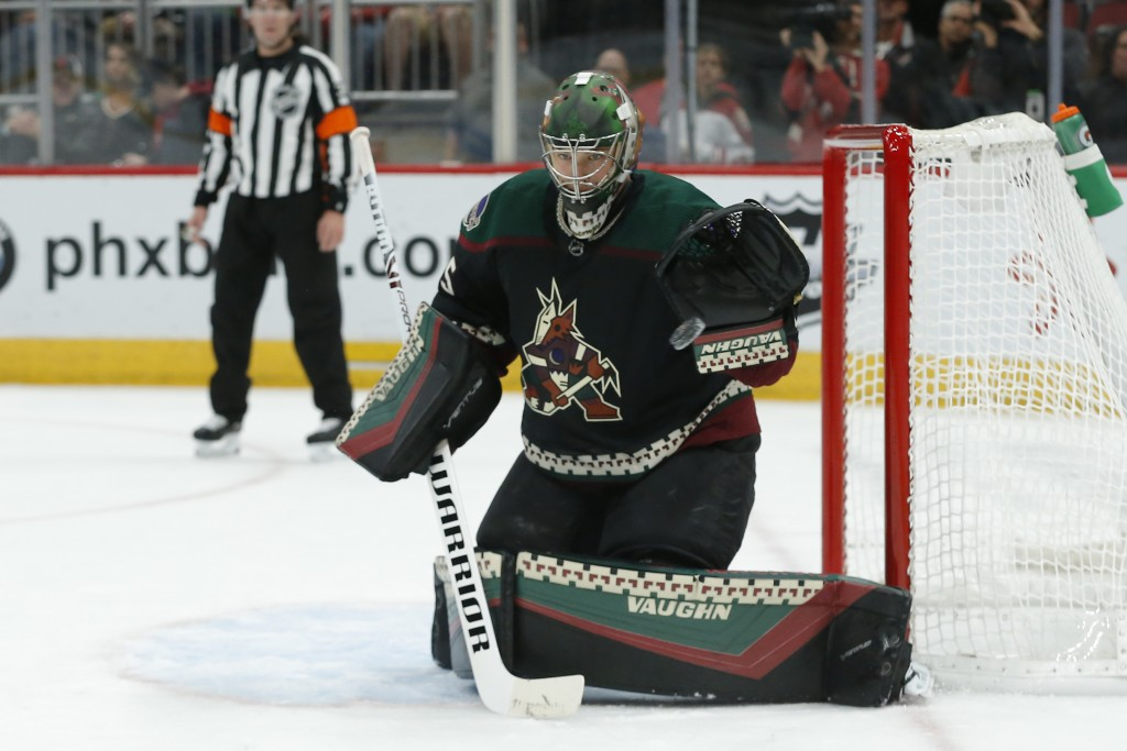 Arizona Coyotes goaltender Darcy Kuemper makes a save on a shot by the Minnesota Wild in the first period during an NHL hockey game, Saturday, Nov. 9,...