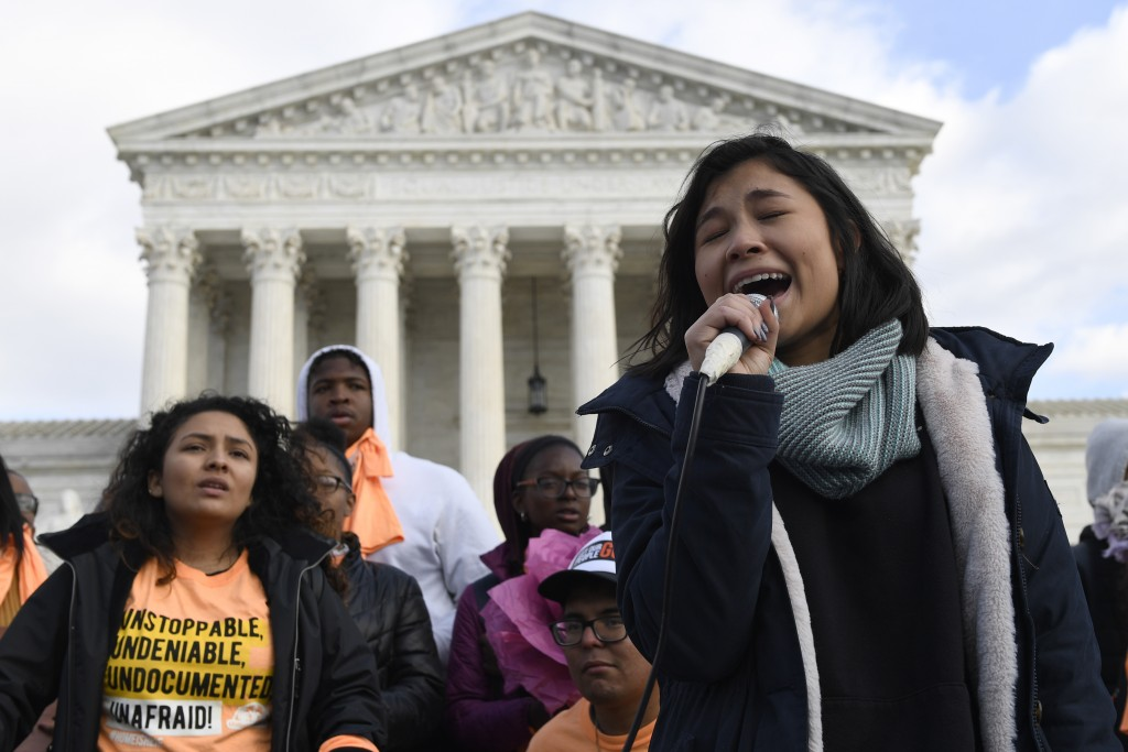 Michelle Lainez, 17, originally from El Salvador but now living in Gaithersburg, Md., speaks during a rally outside the Supreme Court in Washington, F...