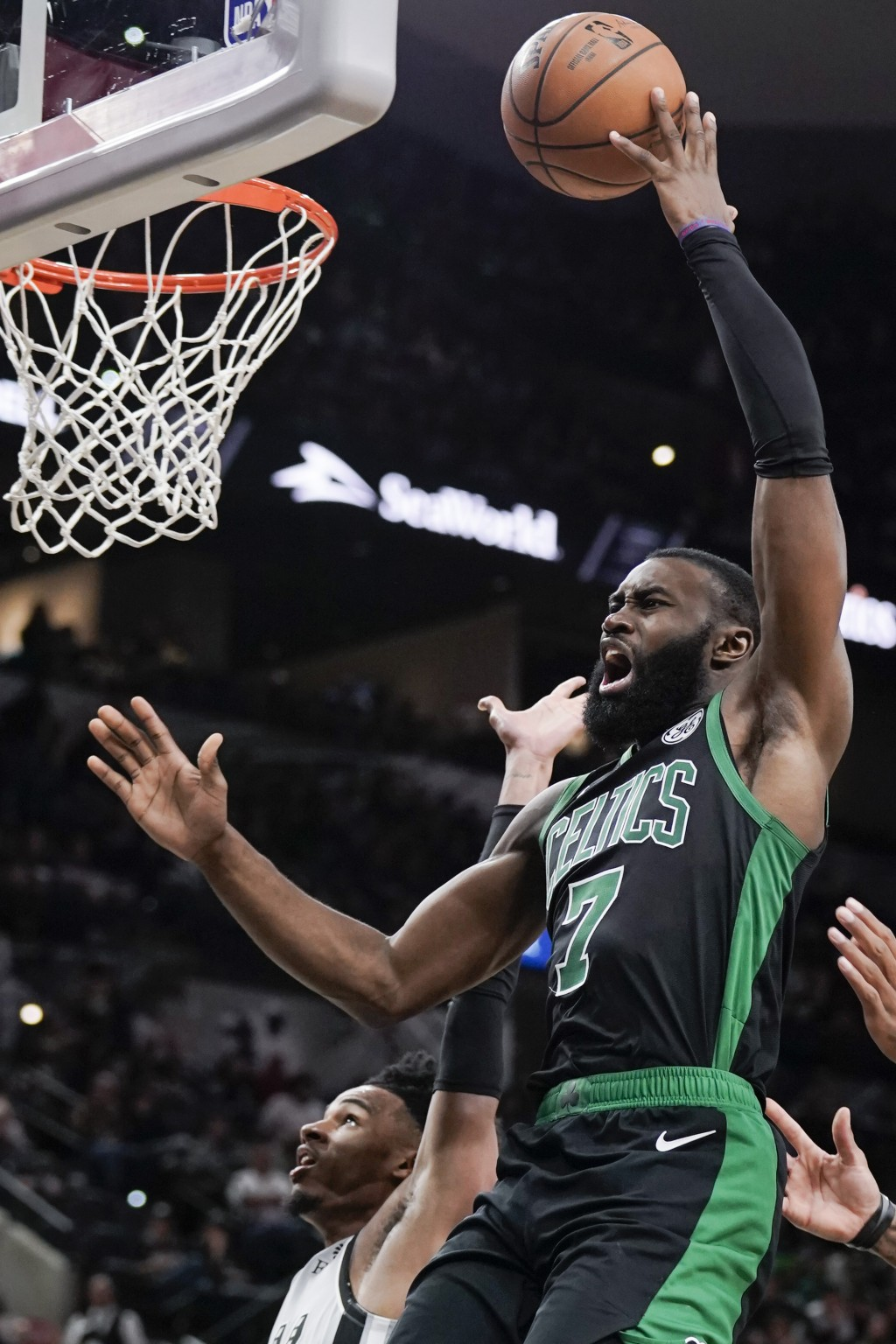 Boston Celtics' Jaylen Brown shoots during the second half of an NBA basketball game against the San Antonio Spurs, Saturday, Nov. 9, 2019, in San Ant...