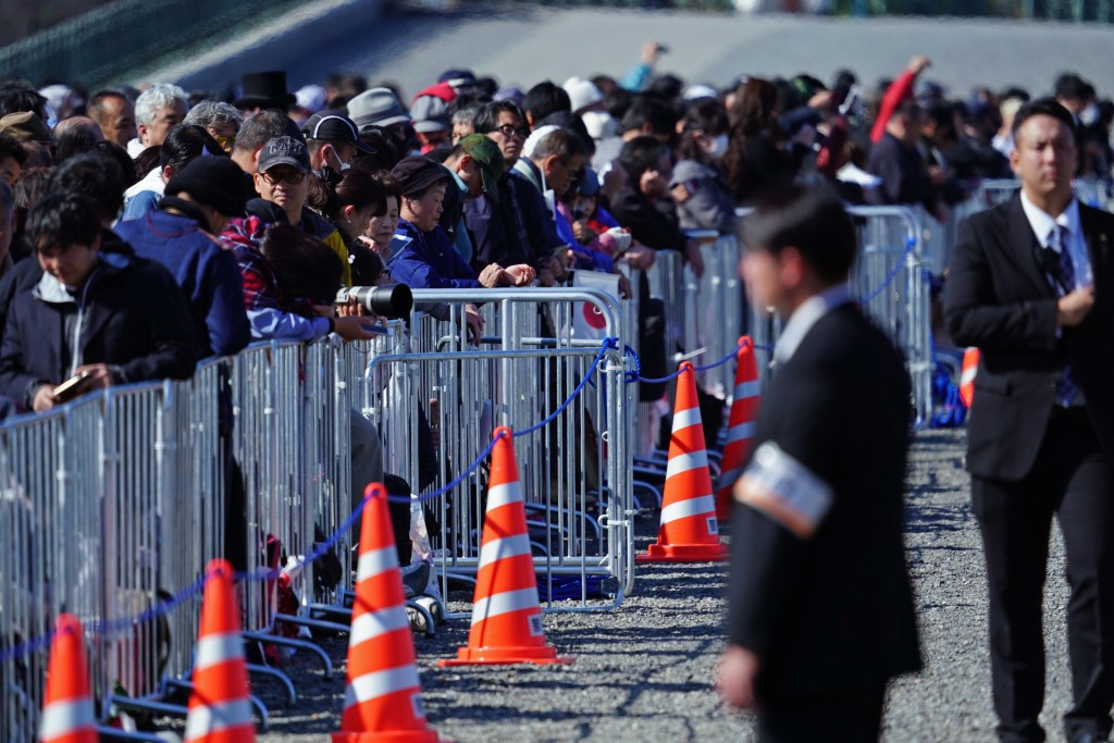 Spectators arrive around the Imperial Palace before the royal parade of Japanese Emperor Naruhito and Empress Masako in Tokyo, Sunday, Nov. 10, 2019. ...