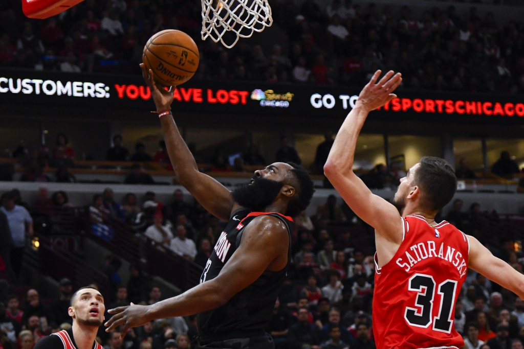 Houston Rockets guard James Harden, left, drives to the basket against Chicago Bulls guard Tomas Satoransky (31) during the first half of an NBA baske...