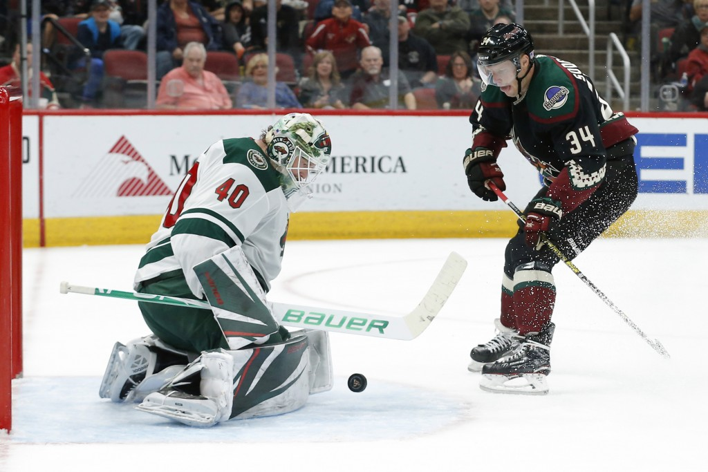 Minnesota Wild goaltender Devan Dubnyk (40) makes the save against Arizona Coyotes center Carl Soderberg in the second period during an NHL hockey gam...