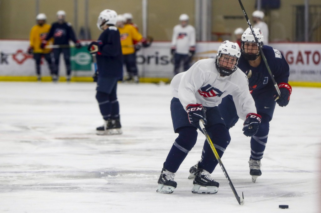 In this photo taken Monday, Nov. 4, 2019, Kendall Coyne-Schofield, center, a member of the U.S. Women's National hockey team, goes through drills duri...