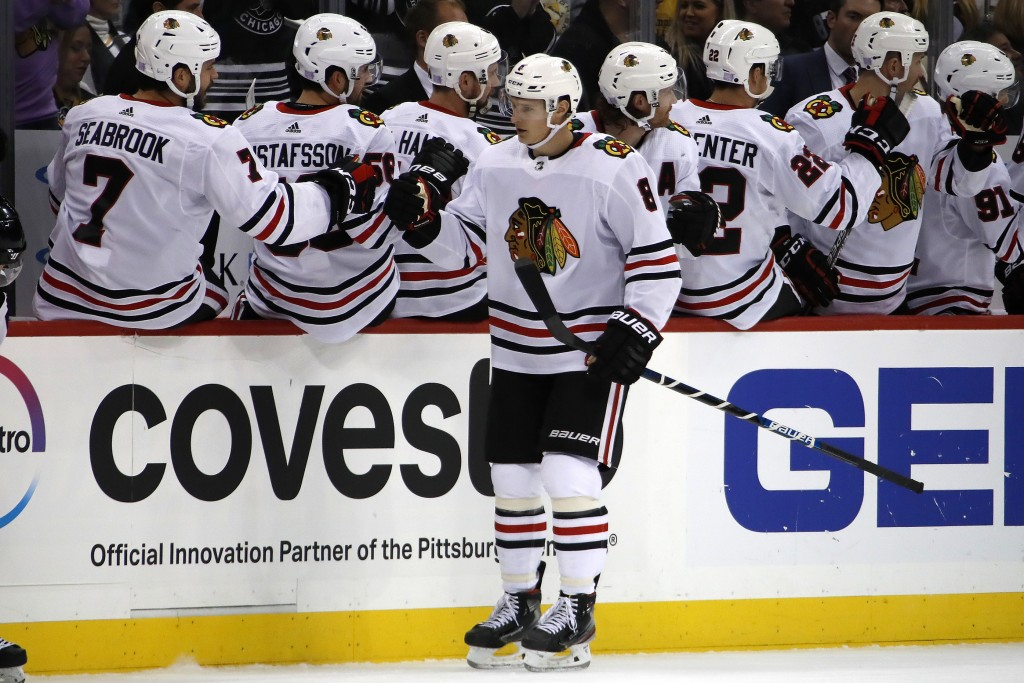 Chicago Blackhawks' Dominik Kubalik (8) returns to the bench after scoring during the second period of an NHL hockey game against the Pittsburgh Pengu...