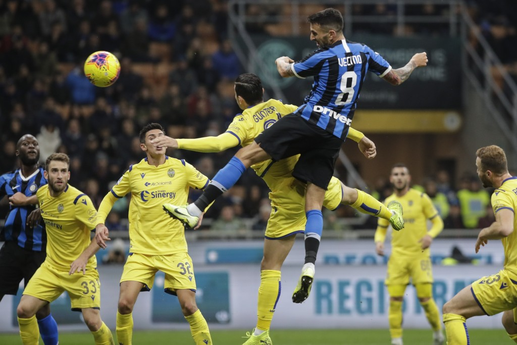 Inter Milan's Matias Vecino scores on a header his side's opening goal during the Serie A soccer match between Inter Milan and Hellas Verona, at the S...