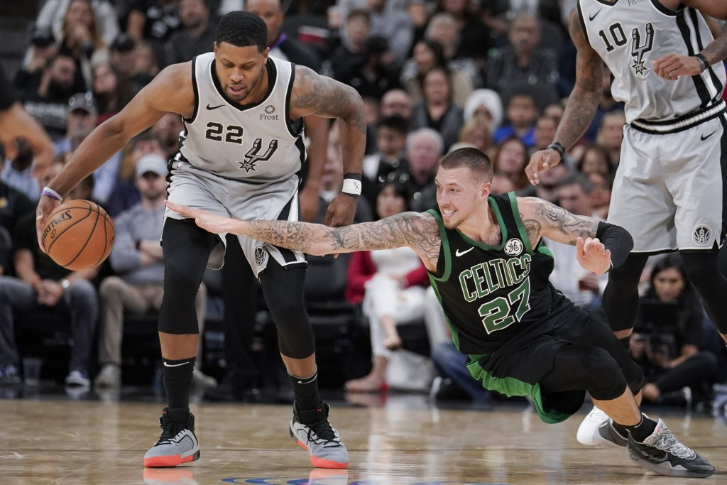 San Antonio Spurs' Rudy Gay (22) beats Boston Celtics' Daniel Theis for possession during the first half of an NBA basketball game, Saturday, Nov. 9, ...