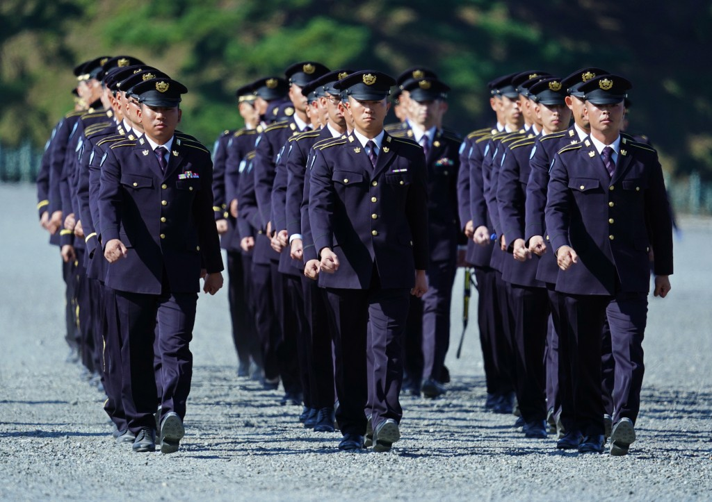 CORRECTS TO JAPAN SELF-DEFENSE FORCES' MEMBERS -  Japan Self-Defense Forces' members walk in formation as they stand guard at the Imperial Palace befo...