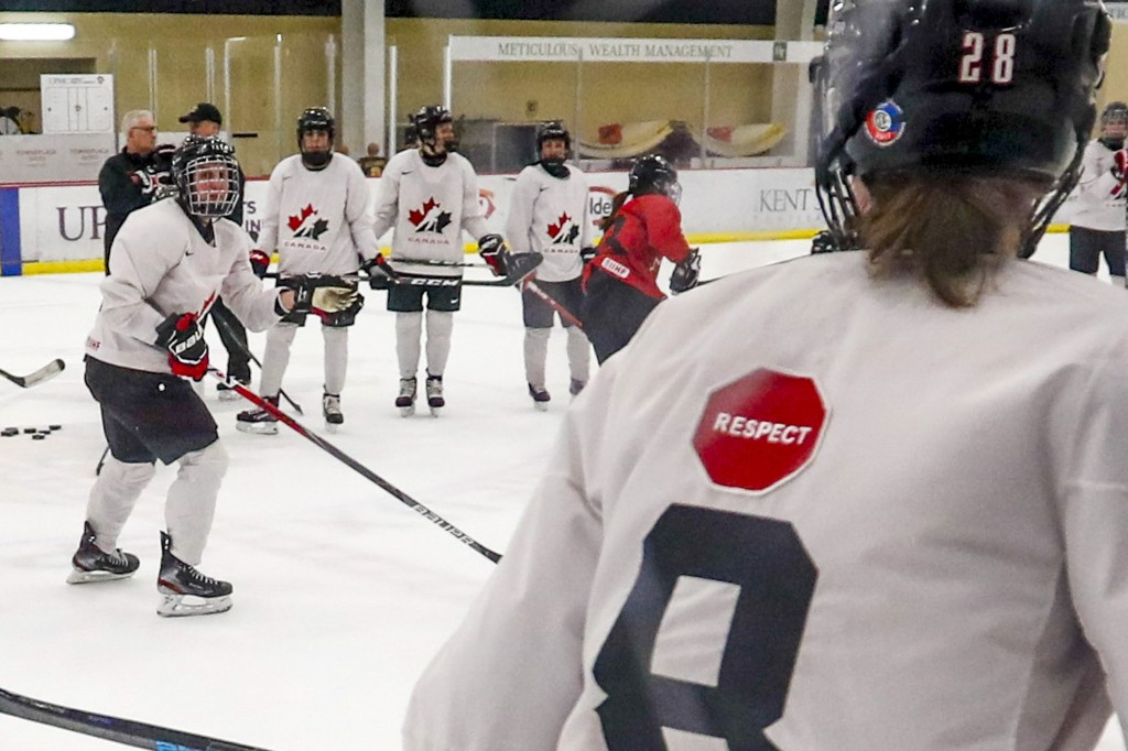 "In this photo taken Monday, Nov. 4, 2019, Micah Hart, right, of the Canada Women's National hockey team, wears a ""respect"" patch on the back of a prac..."