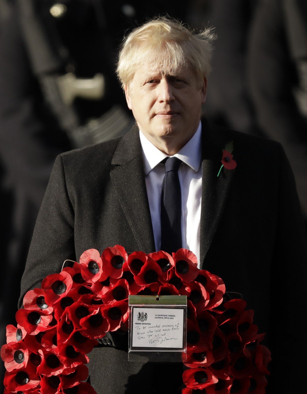 British Prime Minister Boris Johnson prepares to lay a wreath during the Remembrance Sunday ceremony at the Cenotaph in Whitehall in London, Sunday, N...
