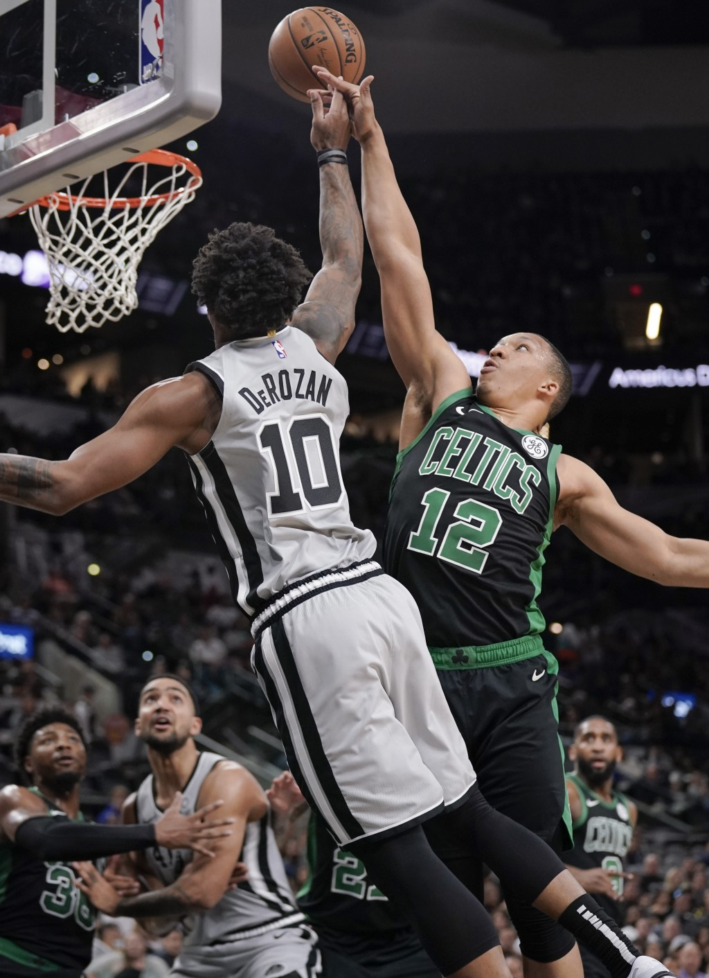San Antonio Spurs' DeMar DeRozan (10) is fouled by Boston Celtics' Grant Williams during the first half of an NBA basketball game, Saturday, Nov. 9, 2...