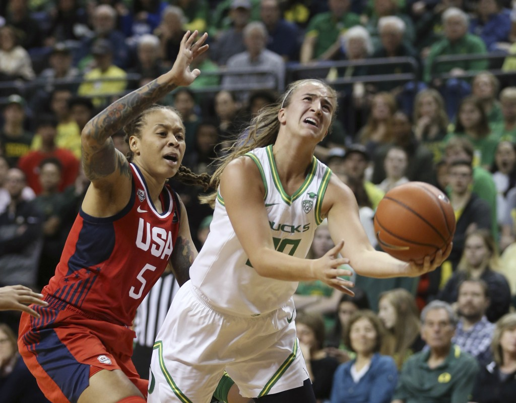 Oregon's Sabrina Ionescu, right, goes up for a shot ahead of United States' Seimone Augustus, left, during the second quarter of an exhibition basketb...