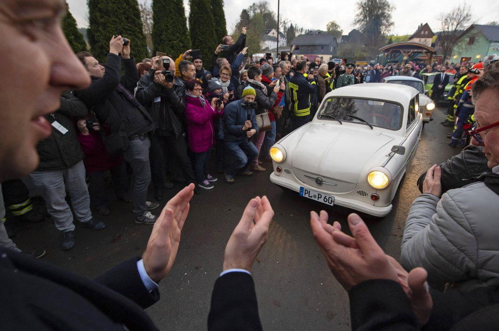 People welcome the legendary GDR cars Trabant (Trabi), during a symbolic wall opening, celebrating the 30th anniversary of the falling wall in the out...