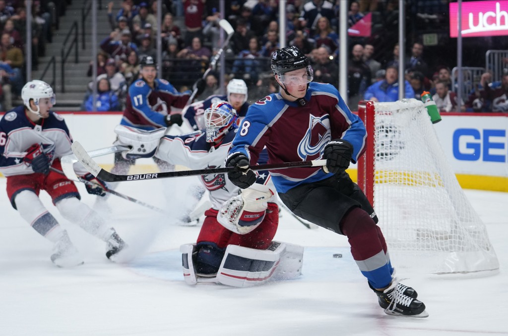Colorado Avalanche defenseman Cale Makar (8) skates past the goal after scoring his second goal of the game against Columbus Blue Jackets goaltender J...