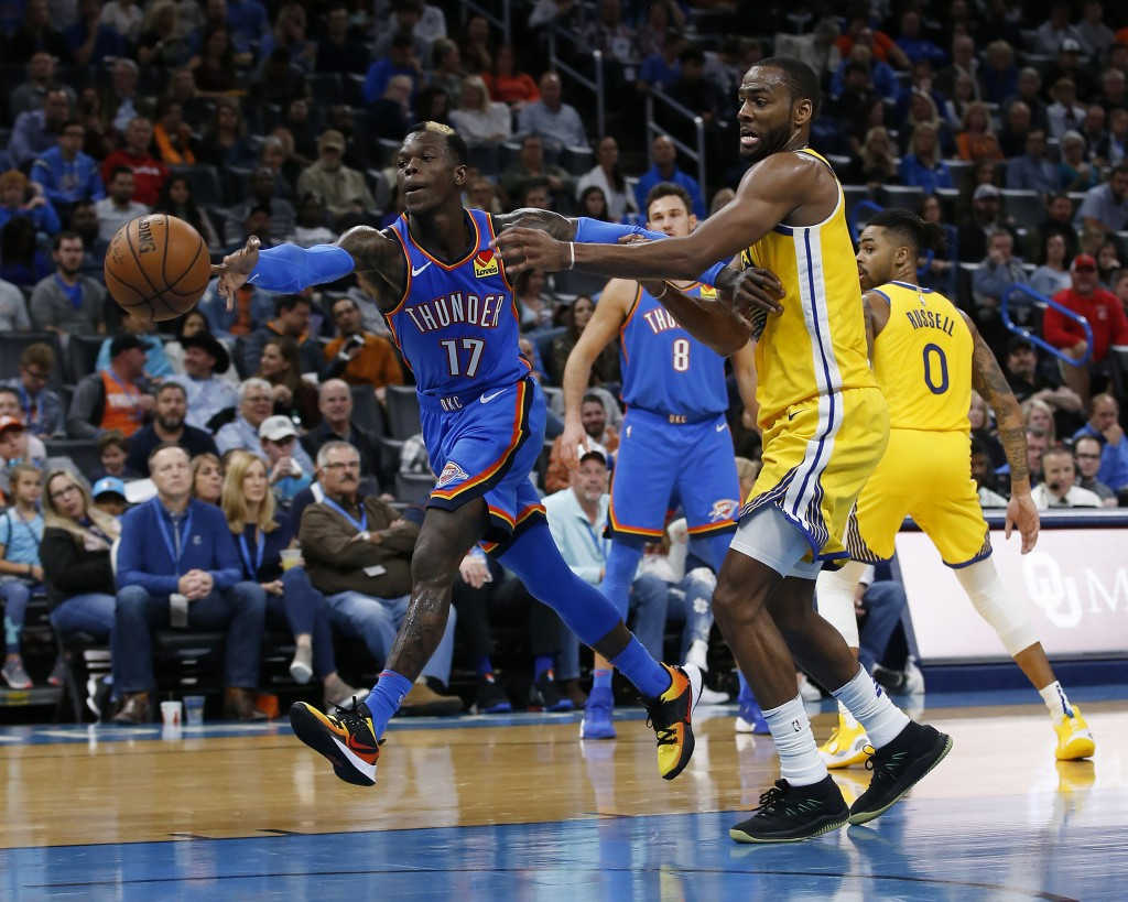 Oklahoma City Thunder's Dennis Schroder (17) fights for the ball with Golden State Warriors' Alec Burks (8) during the second half of an NBA basketbal...