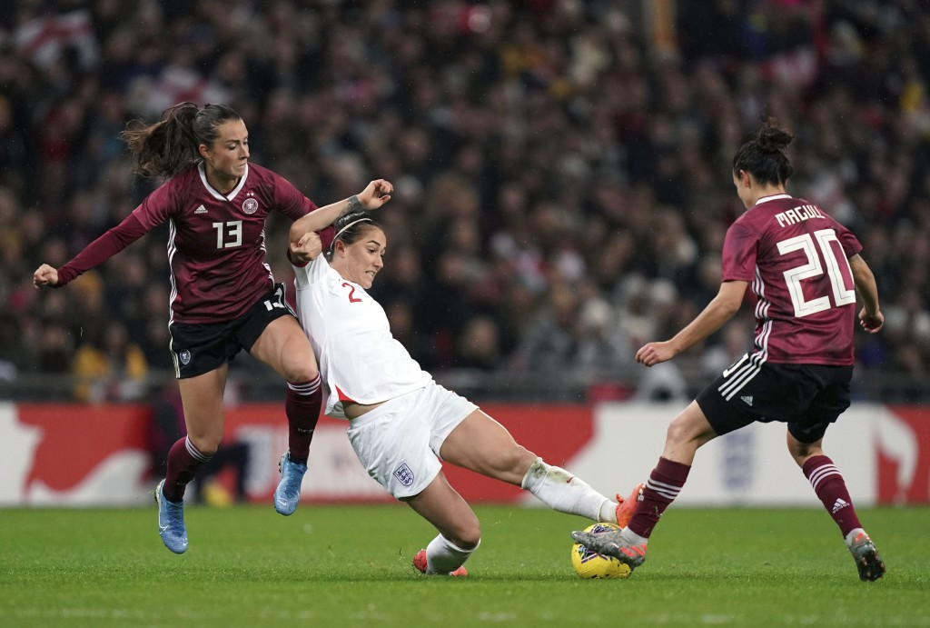 Germany's Sara Dabritz, left and Lina Magull, right, battle for the ball with England's Lucy Bronze , during the Women's International Friendly soccer...