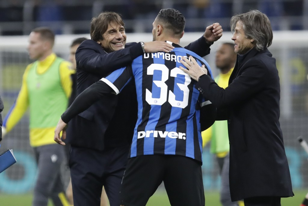 Inter Milan's head coach Antonio Conte, left, celebrates with Danilo D'Ambrosio, center, and team manager Gabriele Oriali at the end of the Serie A so...
