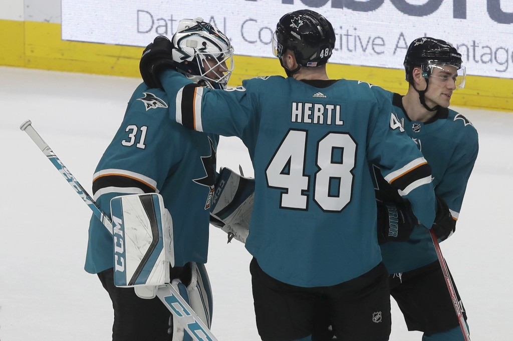 San Jose Sharks goaltender Martin Jones (31) celebrates with Tomas Hertl (48) and Dylan Gambrell after the Sharks defeated the Nashville Predators in ...