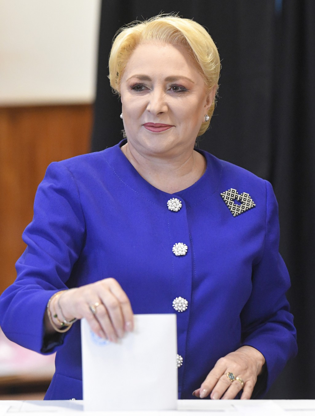 Former Prime Minister and presidential candidate for the Social Democratic party Viorica Dancila casts her vote in Bucharest, Romania, Sunday, Nov. 10...