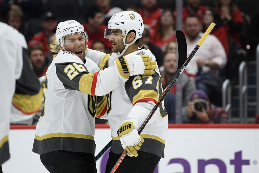Vegas Golden Knights left wing Max Pacioretty (67) celebrates his goal with center Paul Stastny (26) during the first period of an NHL hockey game aga...