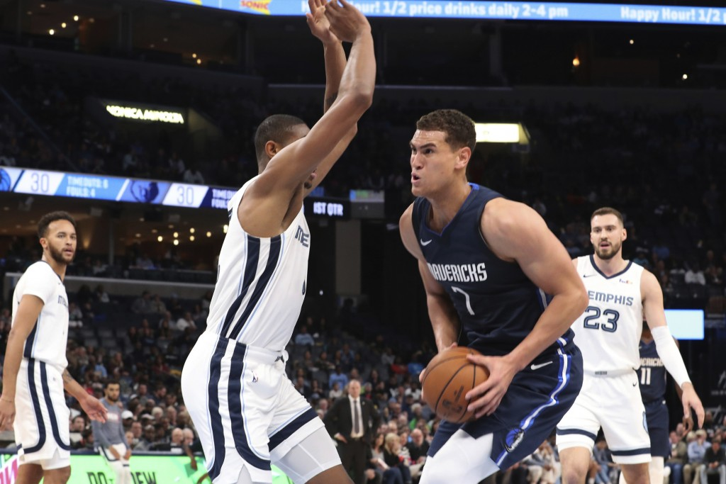 Memphis Grizzlies' Bruno Caboclo (5) defends against Dallas Mavericks Dwight Powell (7) during the first half of an NBA basketball game Saturday, Nov....