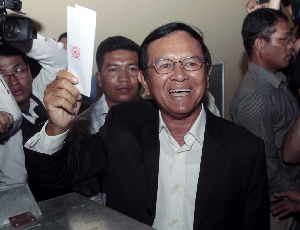FILE - In this June 4, 2017, file photo, then opposition Cambodia National Rescue Party President Kem Sokha shows off his ballot before voting in loca...