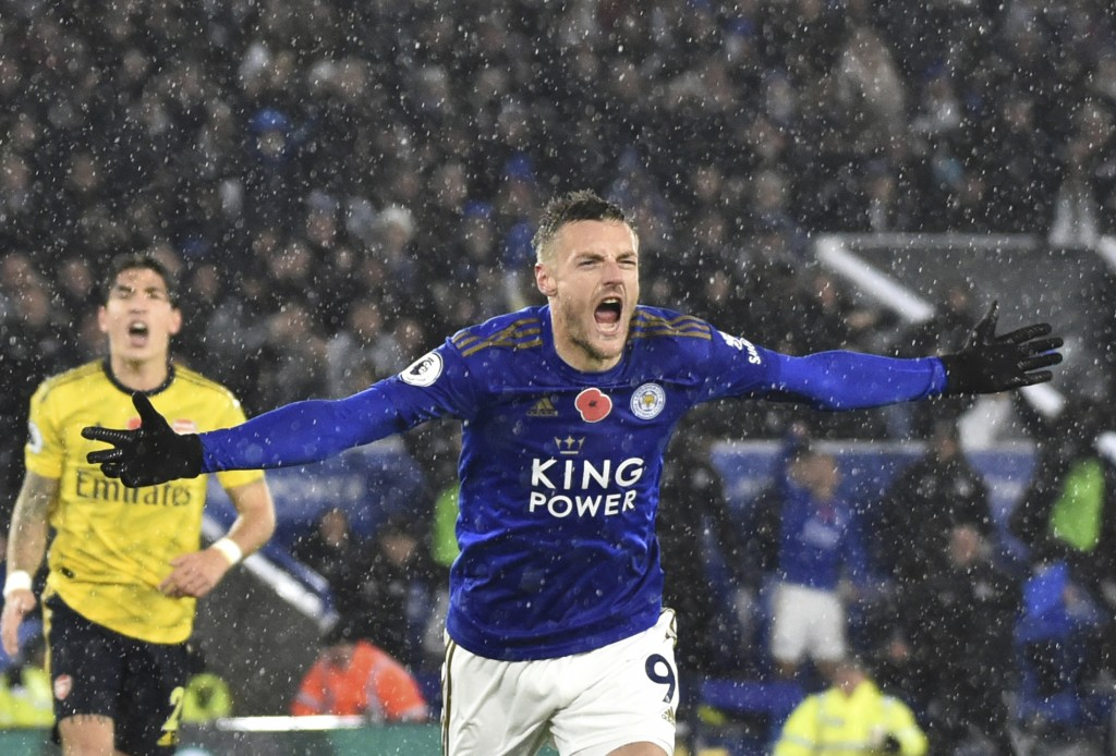 Leicester's Jamie Vardy celebrates after scoring the opening goal during the English Premier League soccer match between Leicester City and Arsenal at...