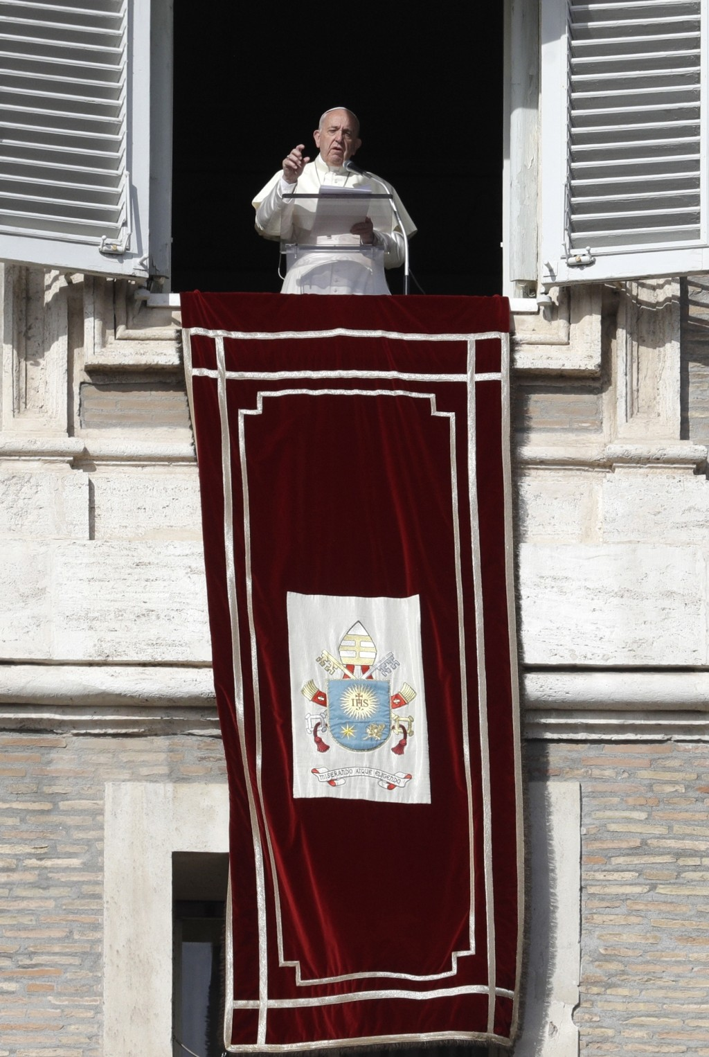 Pope Francis delivers his message during his Angelus prayer from his studio window overlooking St. Peter's Square, at the Vatican, Sunday, Nov. 10, 20...