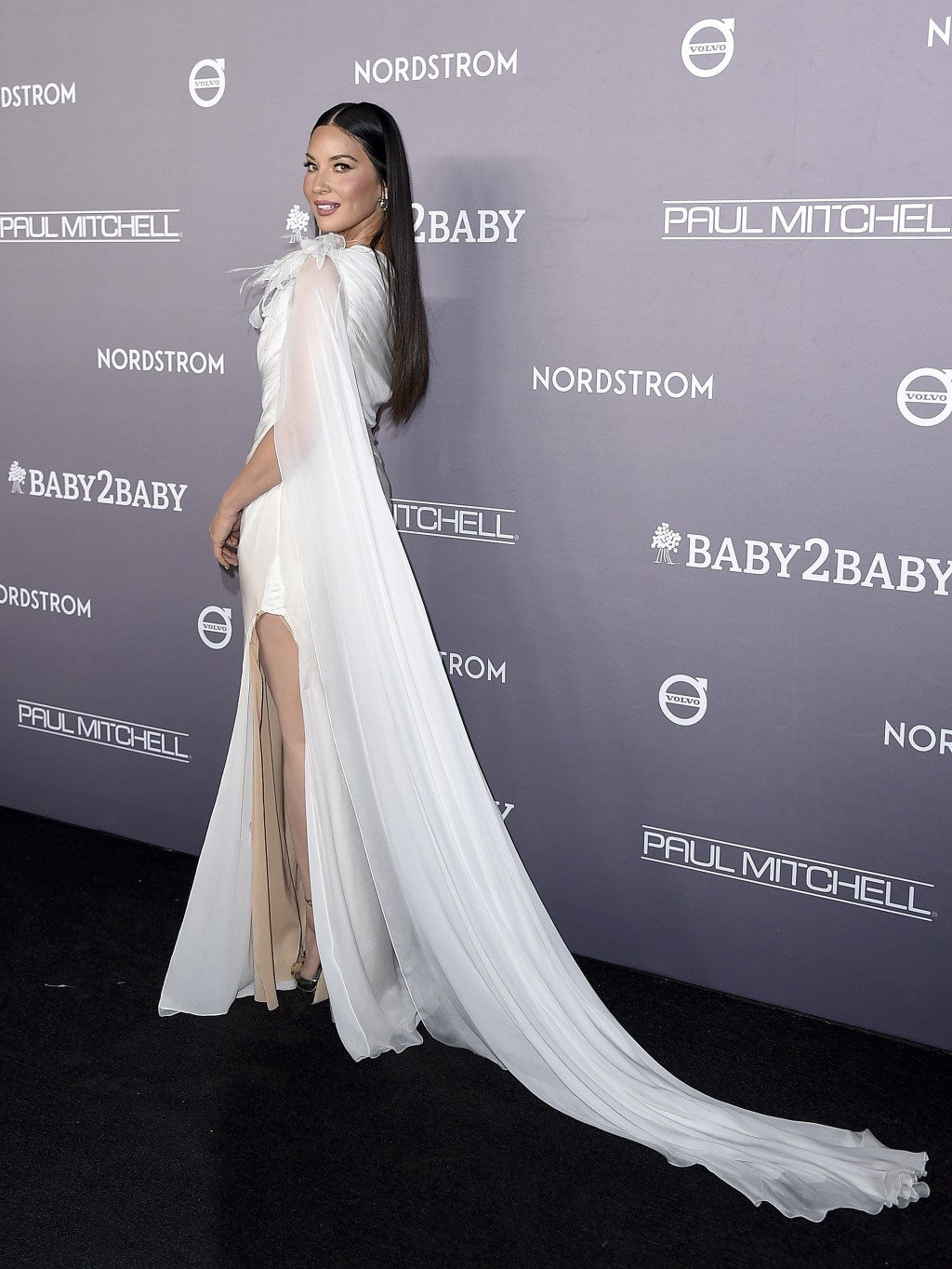 Olivia Munn arrives at the 2019 Baby2Baby Gala on Saturday, Nov. 9, 2019, in Culver City, Calif. (Photo by Jordan Strauss/Invision/AP)