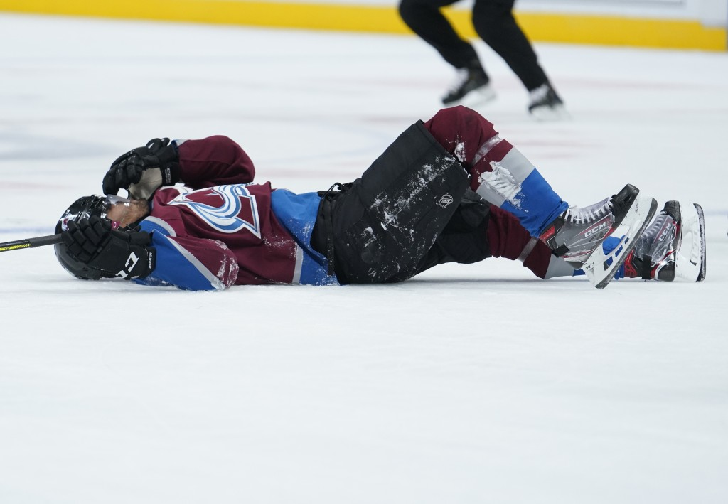 Colorado Avalanche left wing Pierre-Edouard Bellemare lies on the ice after being hit by Columbus Blue Jackets left wing Nick Foligno during the secon...