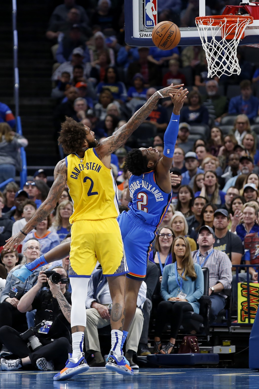 Oklahoma City Thunder's Shai Gilgeous-Alexander shoots against Golden State Warriors' Willie Cauley-Stein (2) during the first half of an NBA basketba...