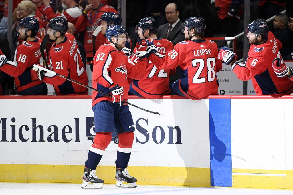 Washington Capitals center Evgeny Kuznetsov (92), of Russia, celebrates his goal during the first period of an NHL hockey game against the Vegas Golde...